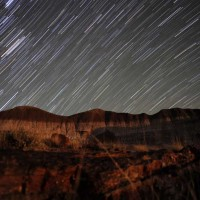 Star trails over bentonite hills