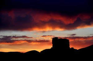 The spectacular sunset silhouettes the tallest wall on the Wupatki Pueblo.