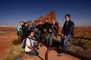 Lit by the nearly full moon, photo students from FALA pose by the Wupatki site. (click to enlarge)