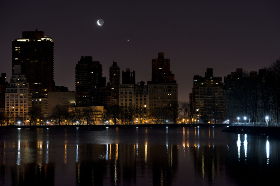 The moon and Venus rise over Manhattan's east side, 2014