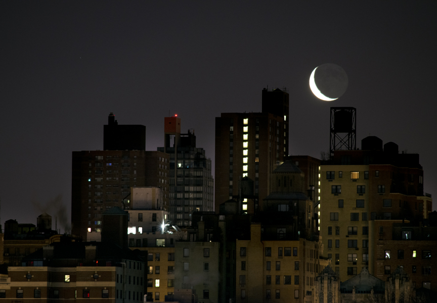 Crescent moon rising over Manhattan's east side, 2014