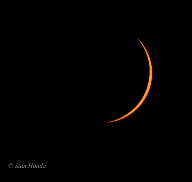 A crescent appears as the moon returns the sun to us