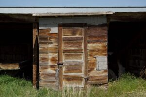 Verne's outhouse, made from salvaged barracks wood and a door.