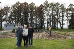 Lois Spiering with son Kelly and daughter-in-law Sylvia, the daughters planting the garden.