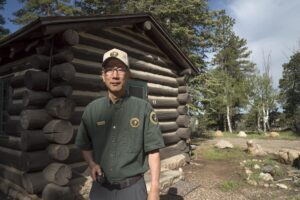 Me in the Volunteer outfit in front of the artist cabin. The canyon is off to the right side. (Click on images to enlarge)