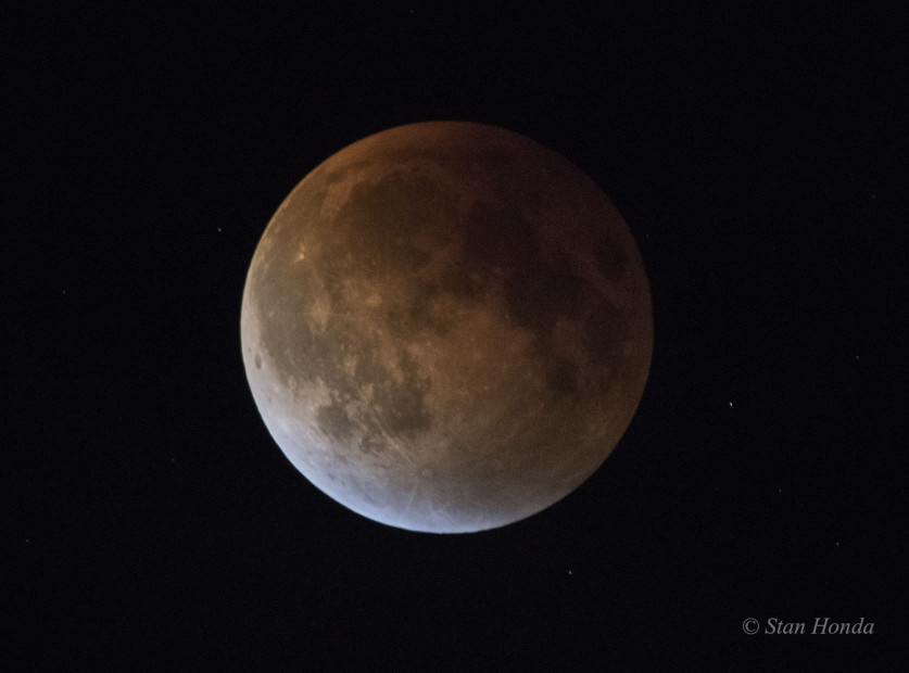 Total Lunar Eclipse, Sept 27, just before the moon recedes from Earth's shadow. Blue light seen on the edge of the moon is sunlight refracted through ozone high in the Earth's atmosphere.