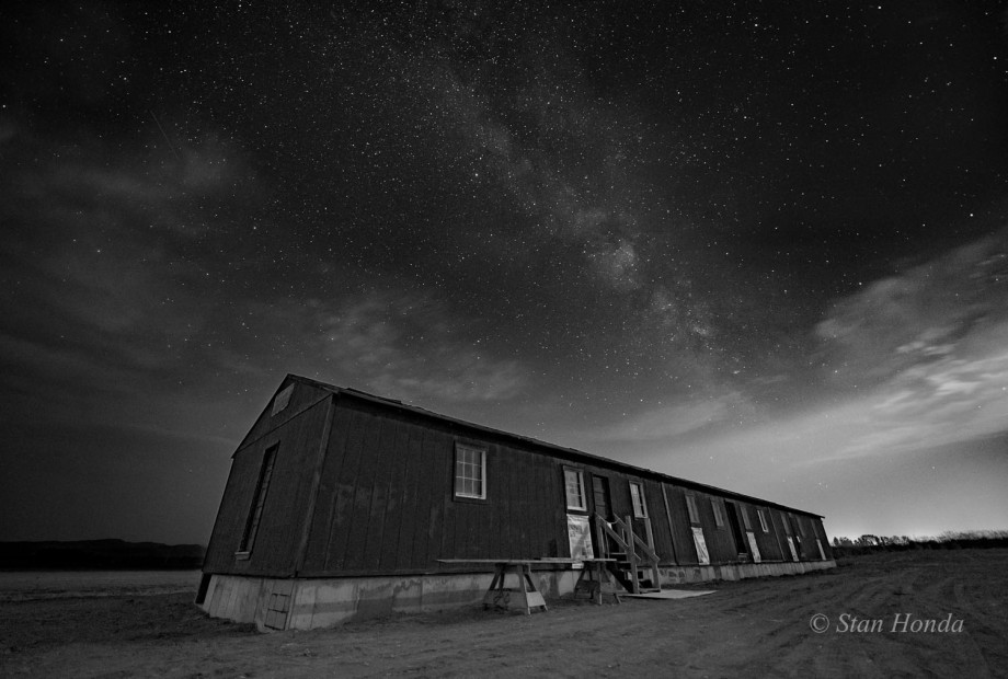 A night scene of an original barracks donated from the Iowa State University geological field camp in Shell, eastern Wyoming, now on the site of the Heart Mountain Interpretive Center.