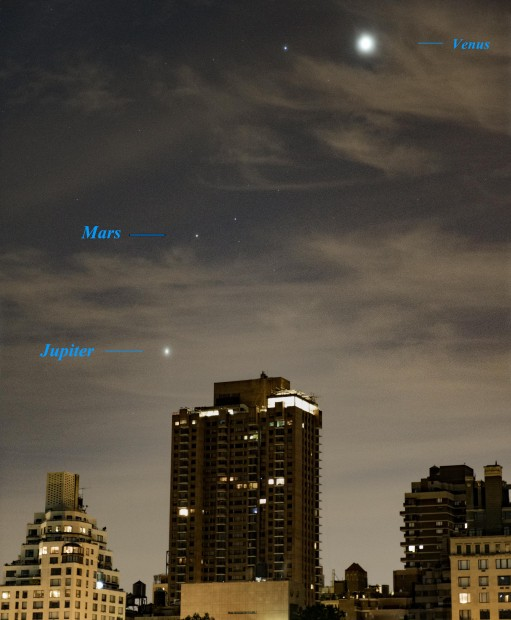 Oct. 7, 2015: Three planets shine through thin clouds over Fifth Avenue buildings.