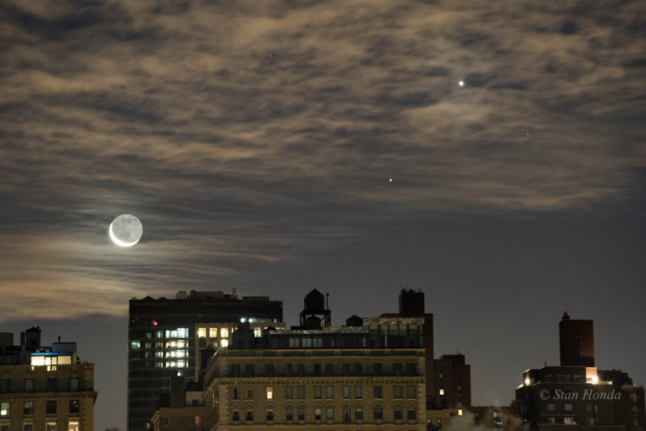 "Jan. 7, 2016: A crescent moon, Saturn and Venus rise above rooftops. A crystal clear atmosphere allows us to see ""earthshine"" on the unlit portion of the moon."