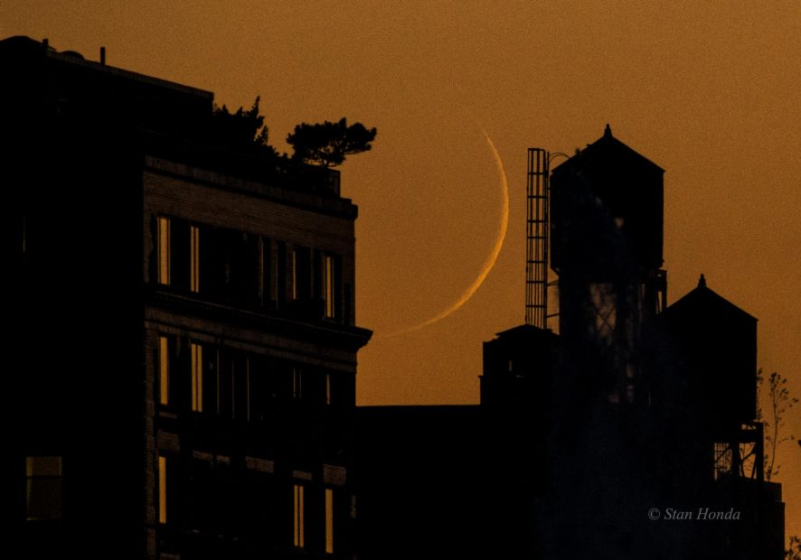 Crescent moon sets on west side of Manhattan, July 5, 2016.