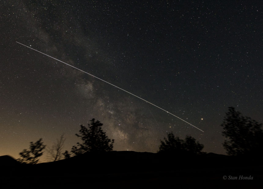 A time exposure of the ISS flying over Rocky